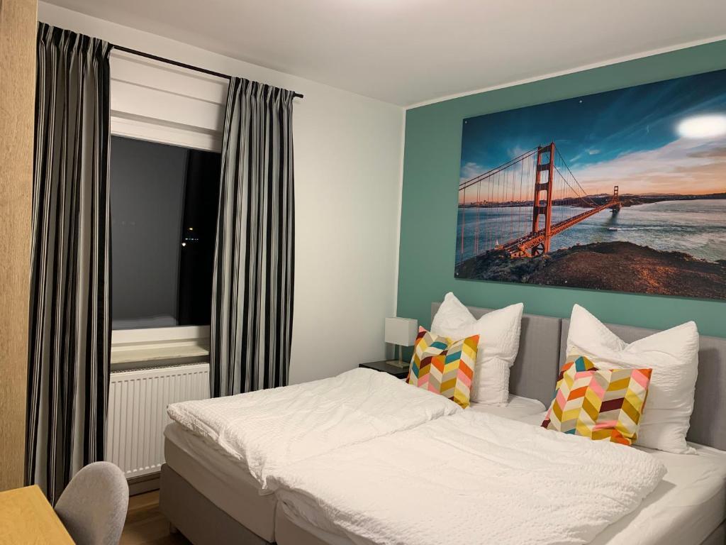 A bed or beds in a room at Apartment Argenta 1 OG mit Balkon