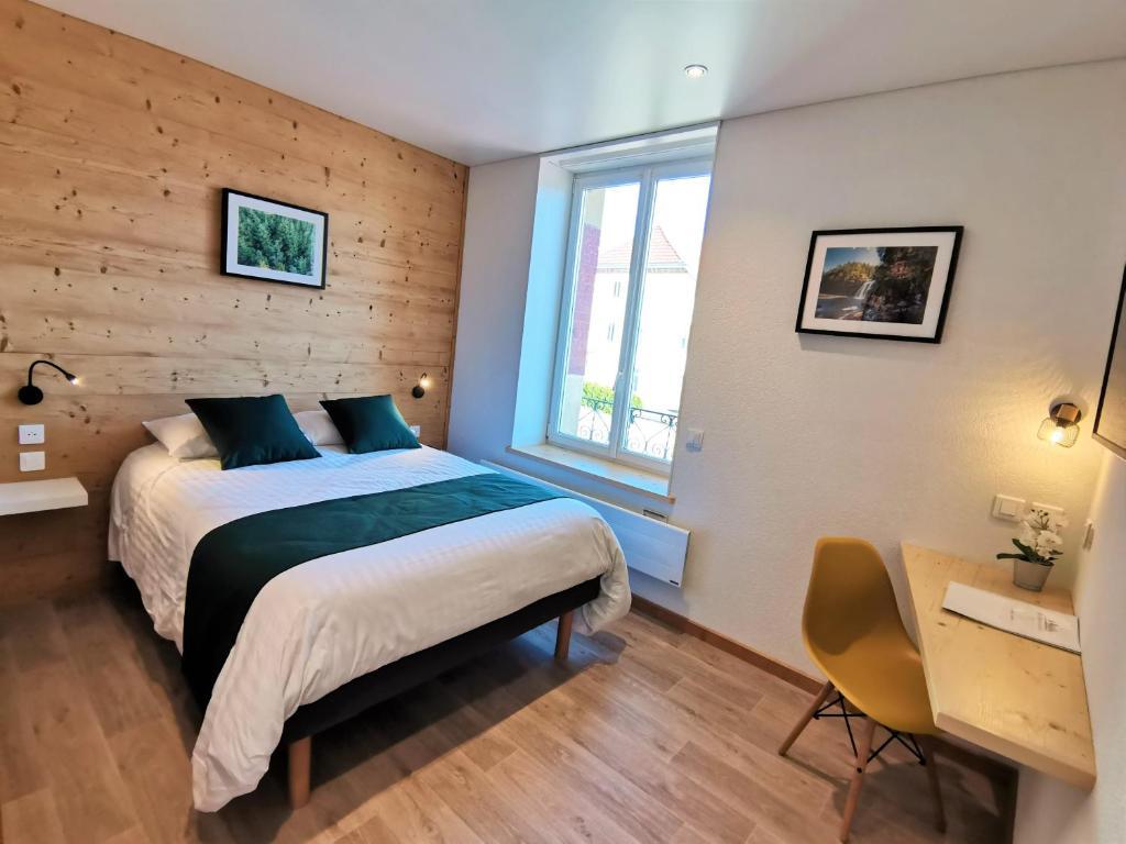 Un ou plusieurs lits dans un hébergement de l'établissement Hotel Les Montagnards