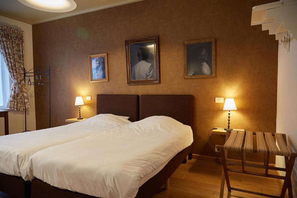 Кровать или кровати в номере Focus Hotel