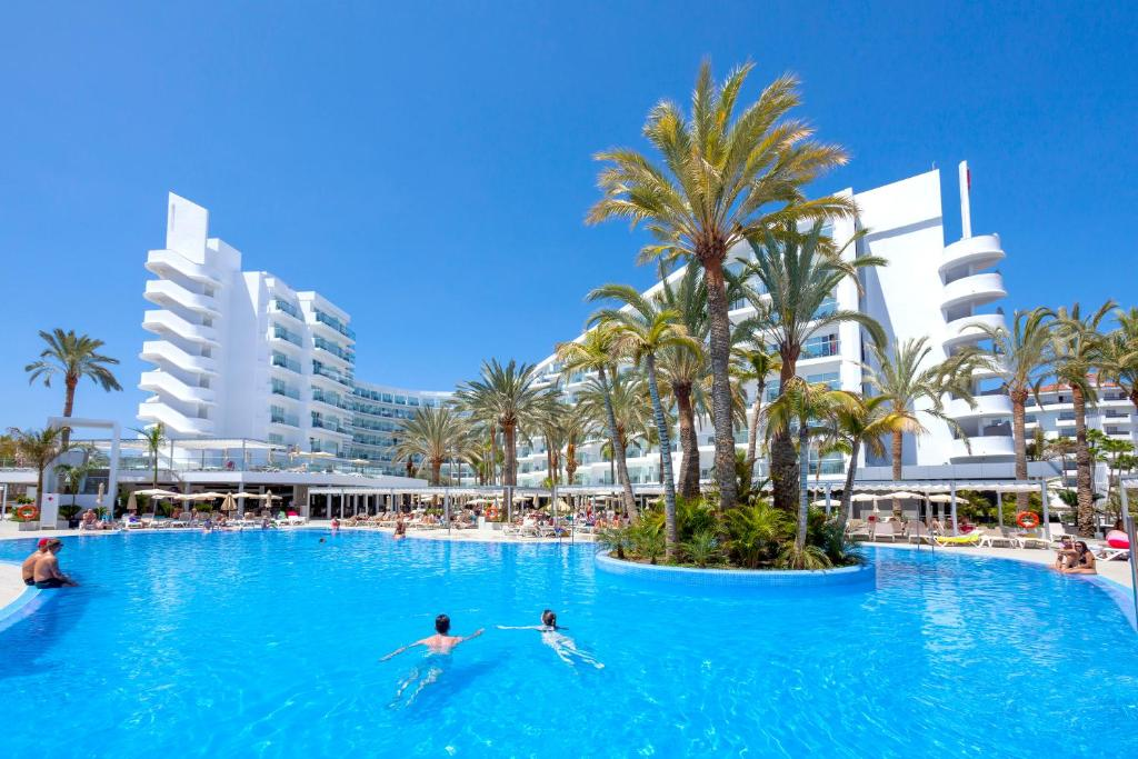 The swimming pool at or near Hotel Riu Papayas - All Inclusive