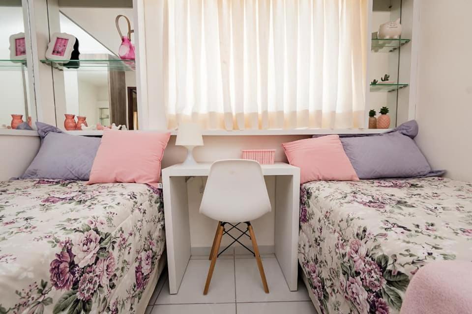 A bed or beds in a room at Casa Sao Gonçalo do Amarante