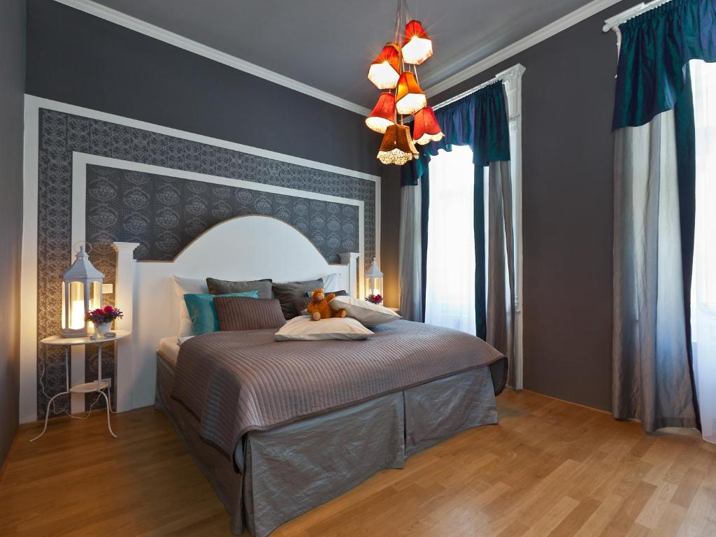 A bed or beds in a room at Royal Prague City Apartments