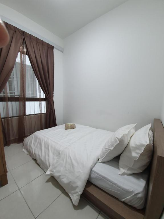 A bed or beds in a room at A29 Benoni Garden Suites