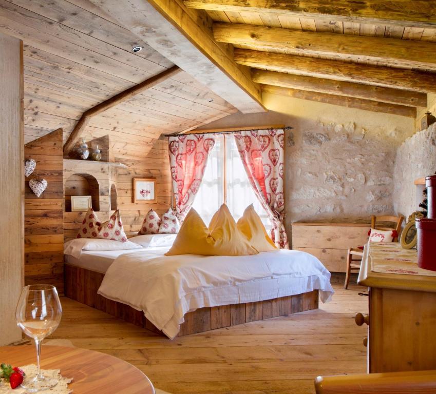 Letto o letti in una camera di Chalet Sogno di Fiaba