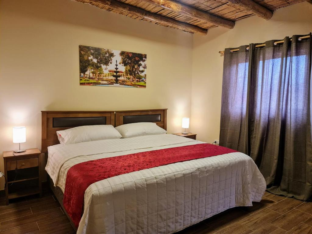 A bed or beds in a room at Villa Monica