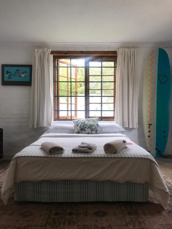 A bed or beds in a room at Hermanus surf school and Lodge