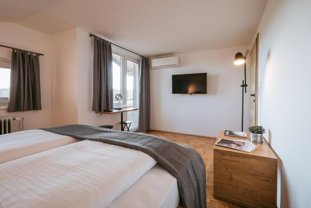 A bed or beds in a room at Guest house Hiša Budja