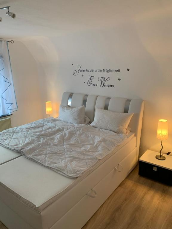 A bed or beds in a room at Beti Apartment