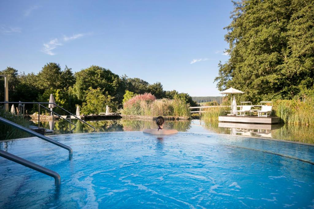 The swimming pool at or near Quellenhotel Heiltherme Bad Waltersdorf - 2-Thermenresort