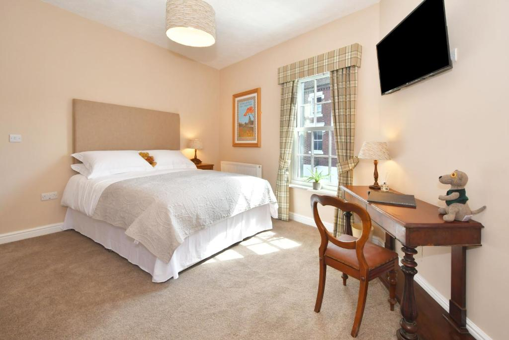 A bed or beds in a room at The Sutherland Arms