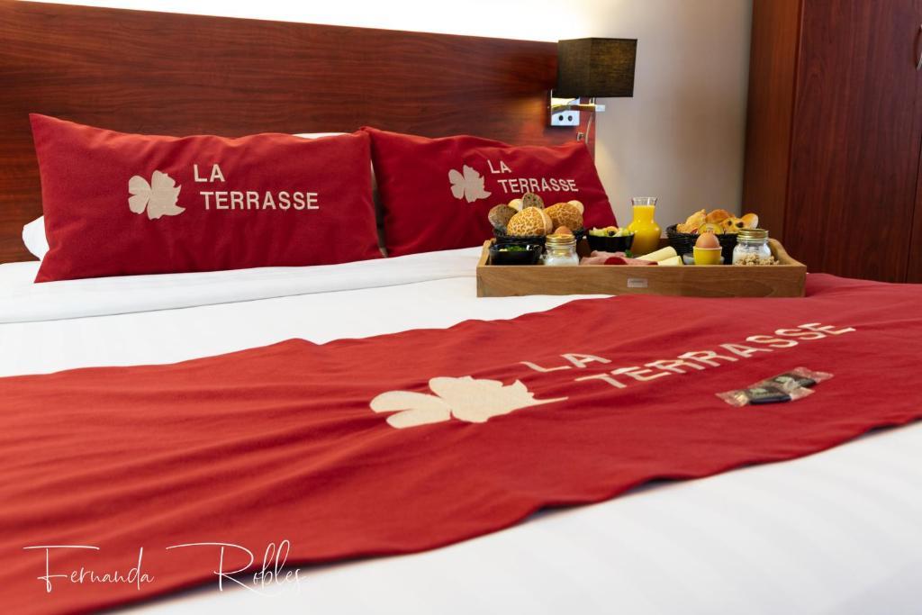 Un ou plusieurs lits dans un hébergement de l'établissement Hotel La Terrasse