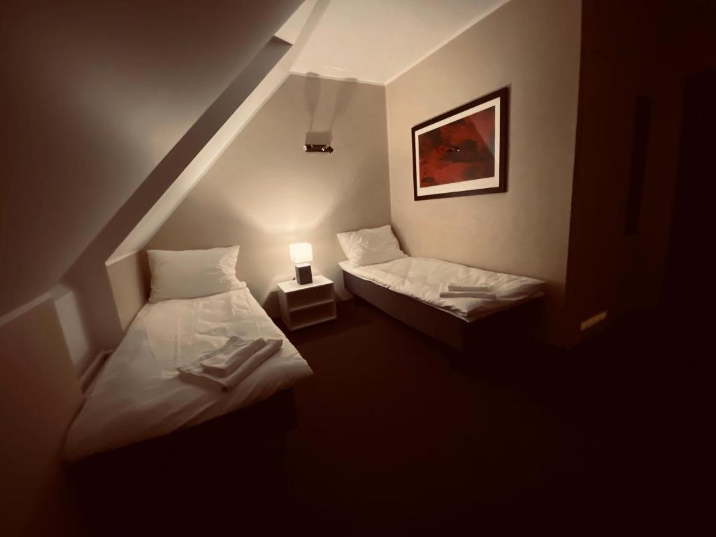 Voodi või voodid majutusasutuse ML Guesthouse toas