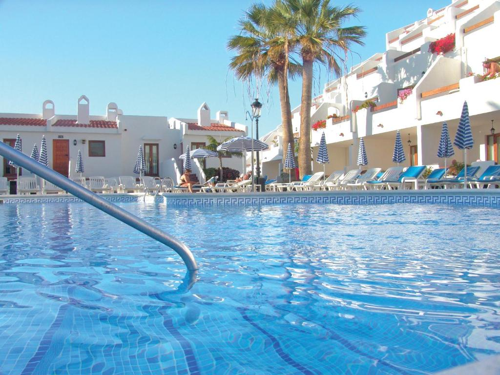 The swimming pool at or near Beverly Hills Suites - Excel Hotels & Resorts