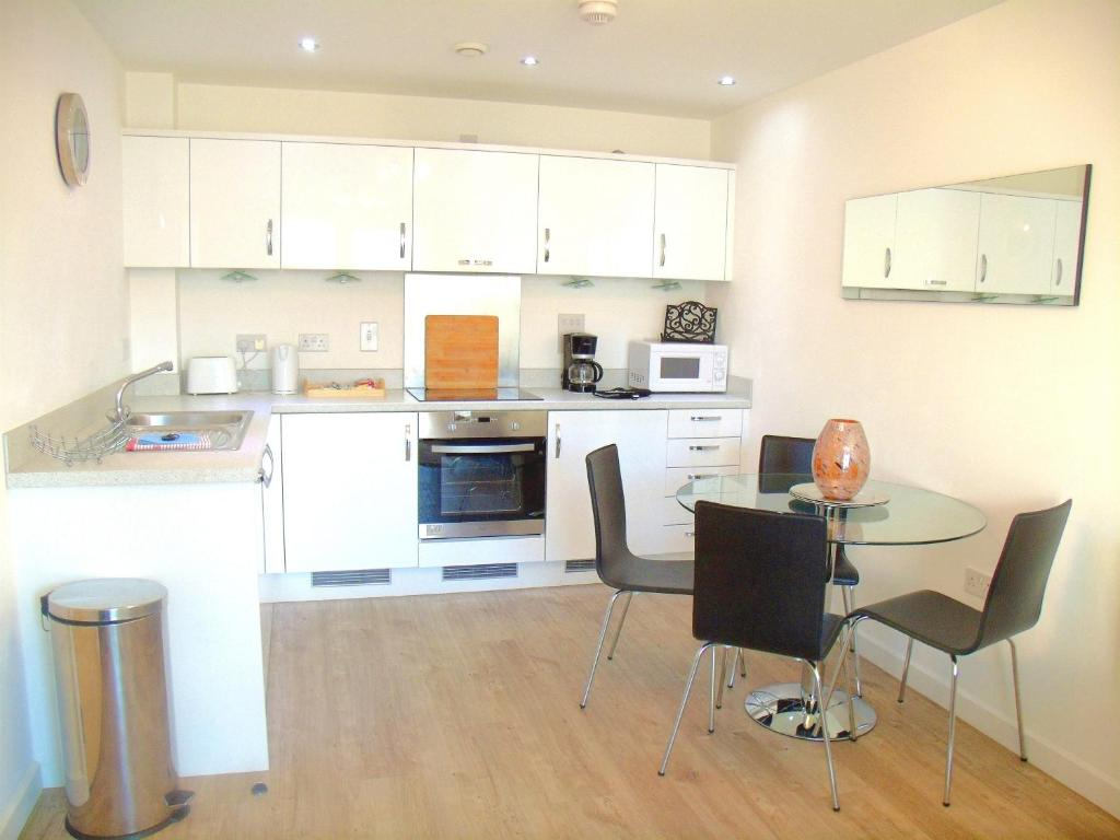 A kitchen or kitchenette at New Central Woking 1 and 2 Bedroom Apartments