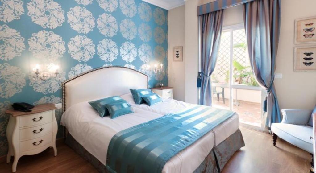 Säng eller sängar i ett rum på Hotel Central Boutique