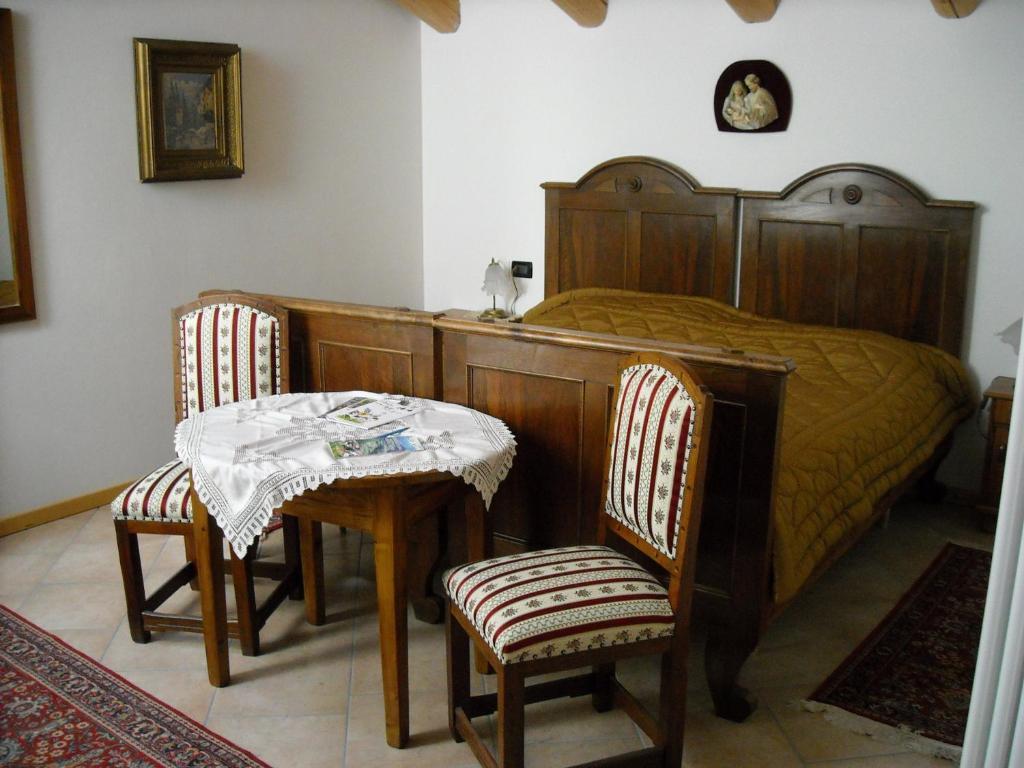 Letto o letti in una camera di La Cort Di Nonna Rosa