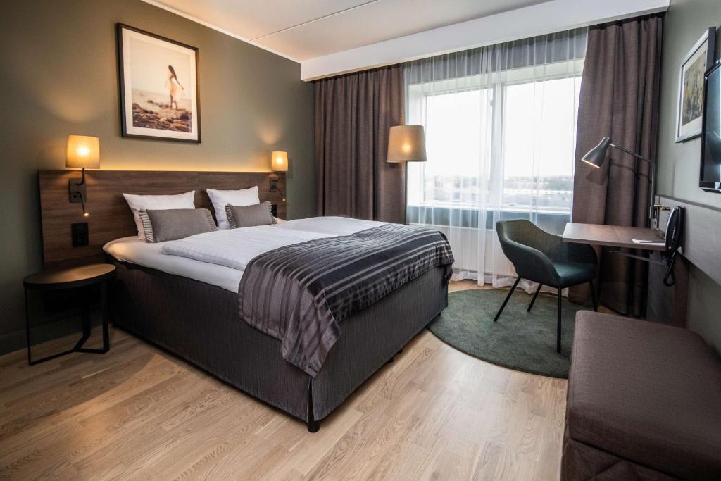 En eller flere senge i et værelse på Scandic Kolding