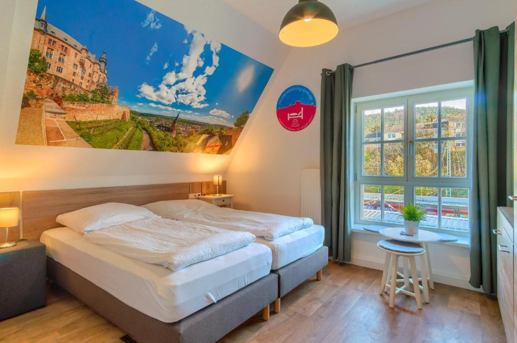 A bed or beds in a room at Hostel-Marburg-one