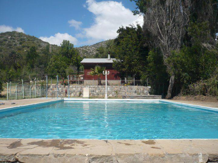 The swimming pool at or near El Parador de Caleu