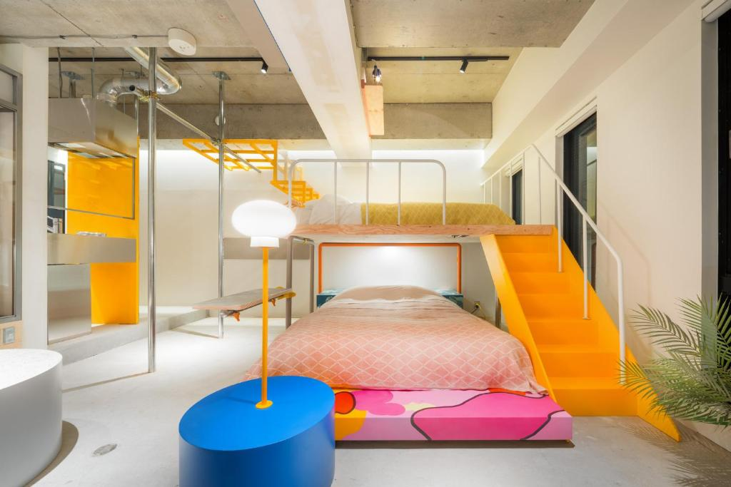 A bunk bed or bunk beds in a room at Artist Hotel - BnA STUDIO Akihabara