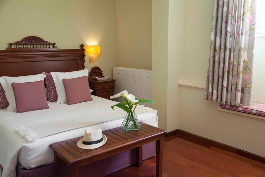 A bed or beds in a room at Casona de La Paca