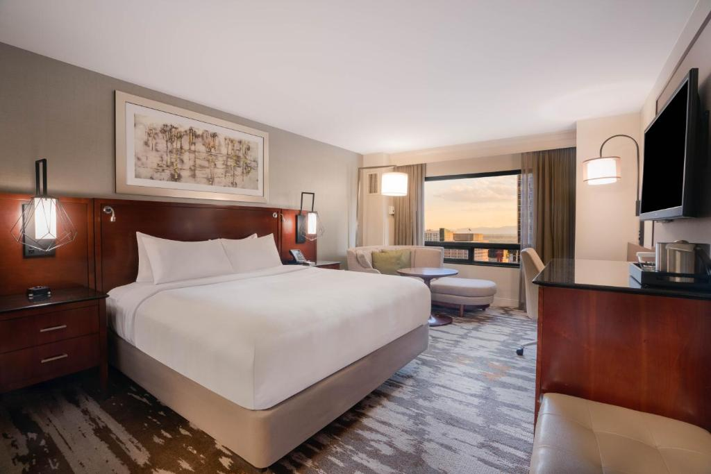 A bed or beds in a room at Hilton Denver City Center