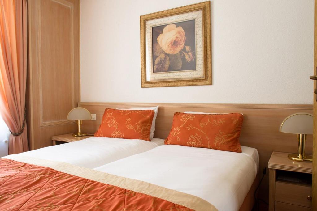 Кровать или кровати в номере Appart'hôtel Résidence CityZen