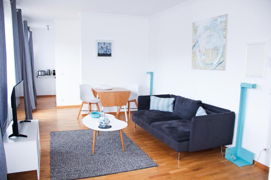 Ein Sitzbereich in der Unterkunft Victoria Apartments