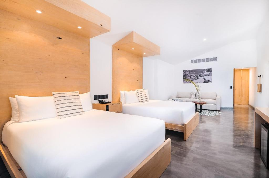 A bed or beds in a room at Bahia Hotel & Beach House