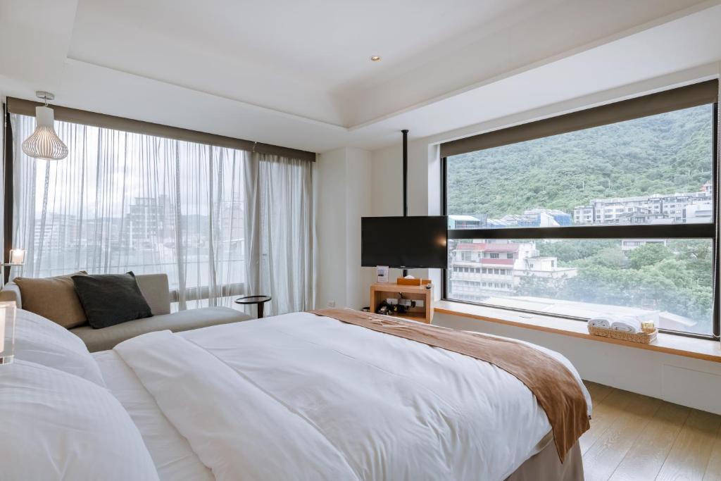 佧美.奧之湯 溫泉民宿房間的床