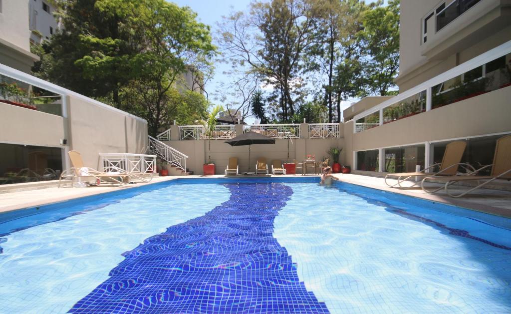 The swimming pool at or near Ez Aclimação Hotel
