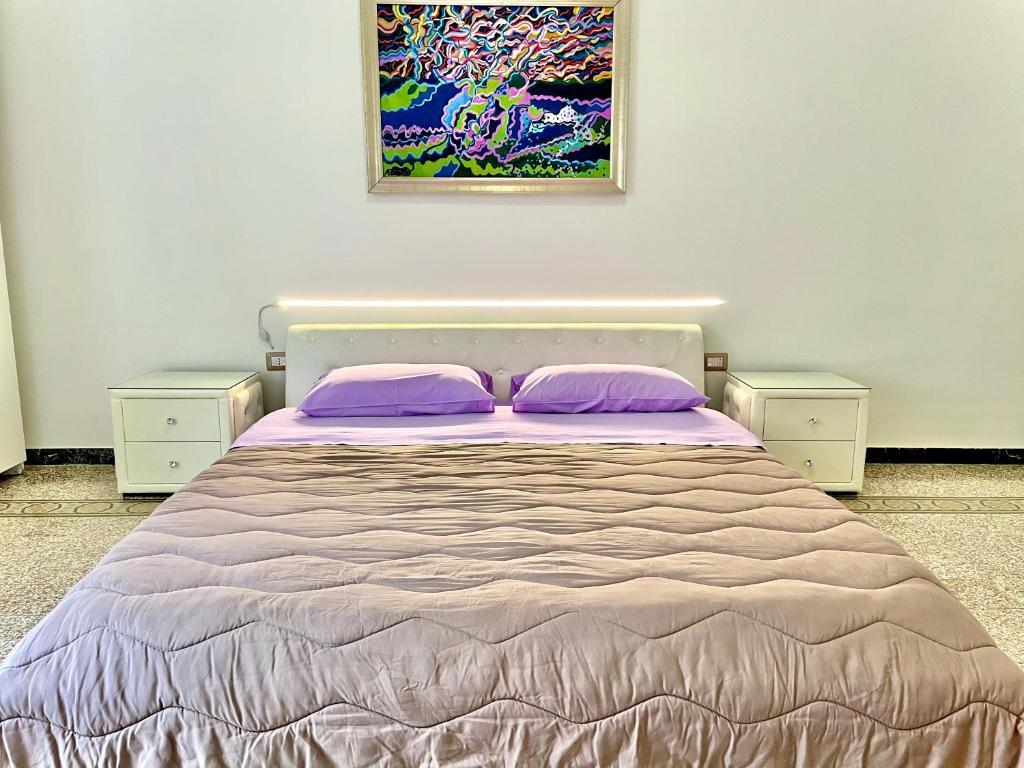 A bed or beds in a room at Camera Matrimoniale privata in appartamento condivisibile