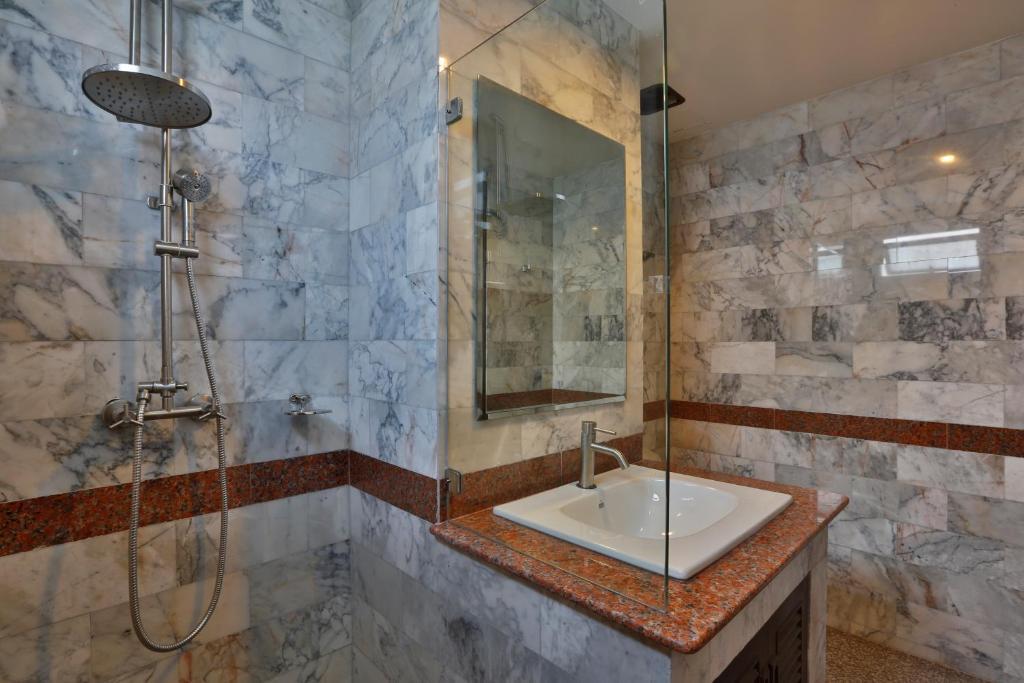 A bathroom at Initial Hua Hin - SHA Plus