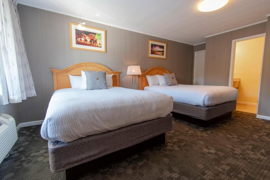 A bed or beds in a room at Marine Village Resort