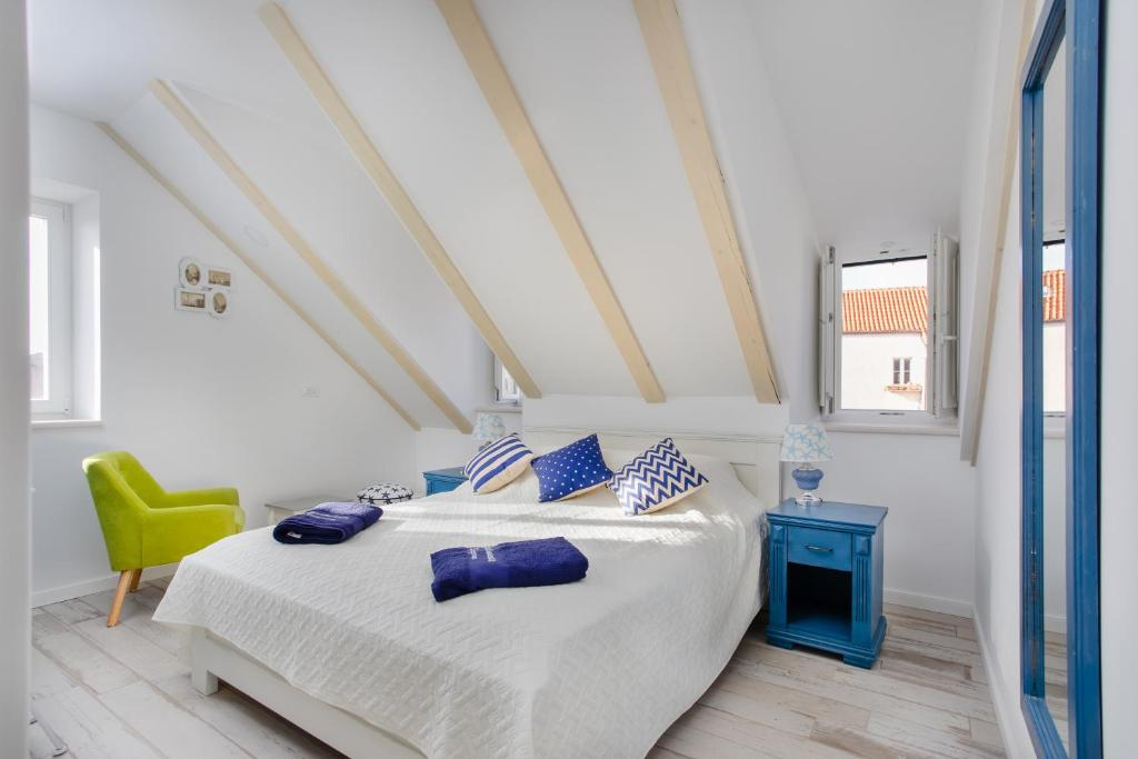 A bed or beds in a room at Stayeva 11