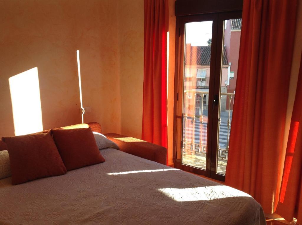 Cama o camas de una habitación en Hotel Julio