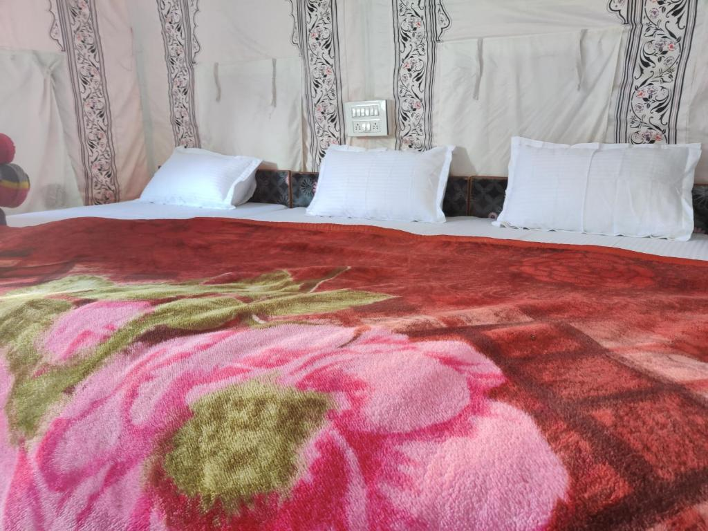 A bed or beds in a room at Magical Mountain Camping and Trekking
