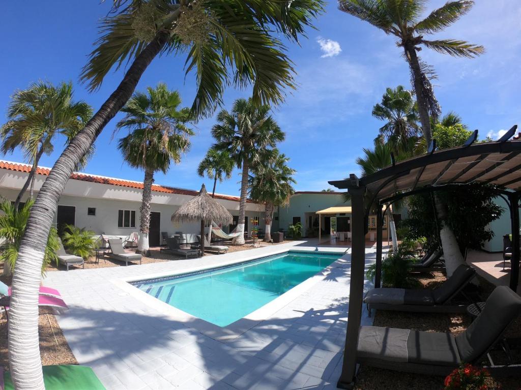 The swimming pool at or near Arubiana Inn Hotel