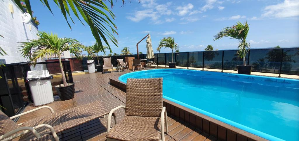 The swimming pool at or near Mar do Cabo Branco Beira Mar