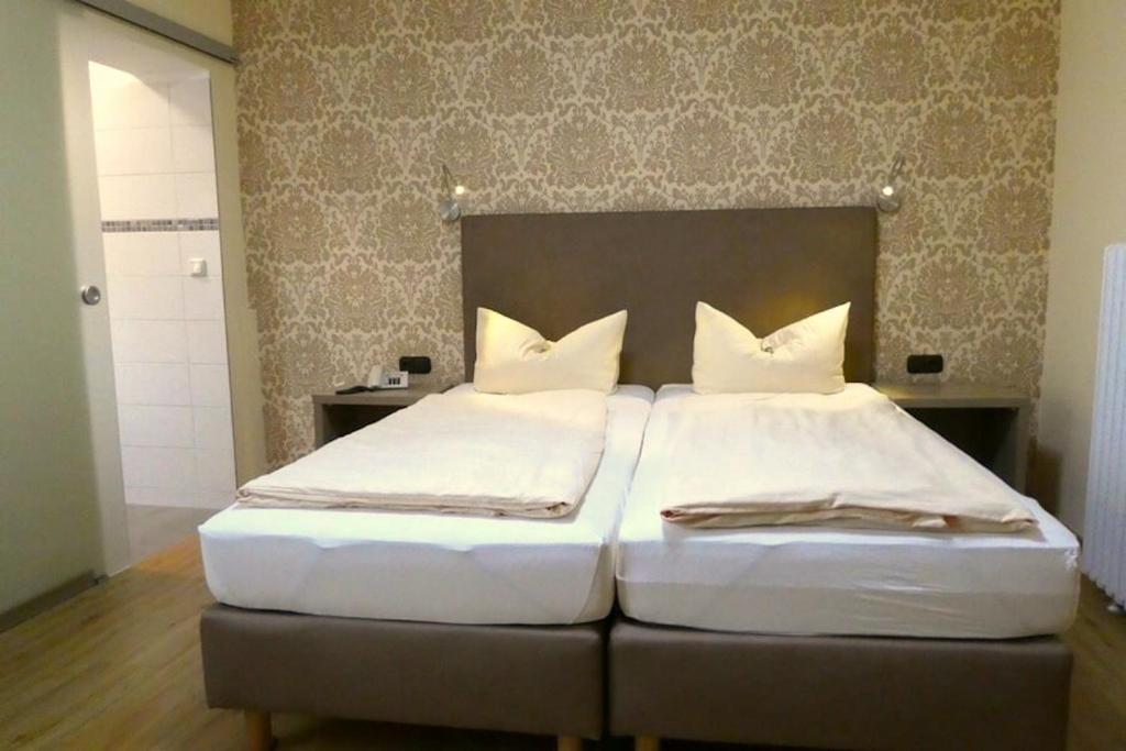 Ein Bett oder Betten in einem Zimmer der Unterkunft Hotel & Restaurant Munzert