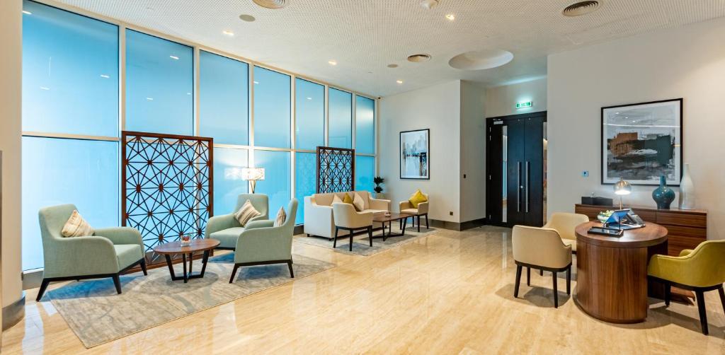 Гостиная зона в Grand Millennium Al Wahda Abu Dhabi