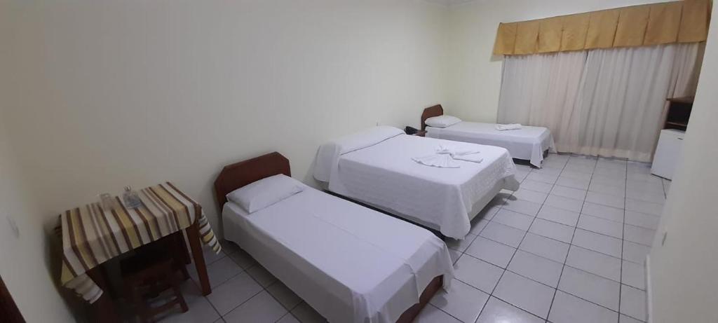 Cama ou camas em um quarto em Capão Praia Hotel