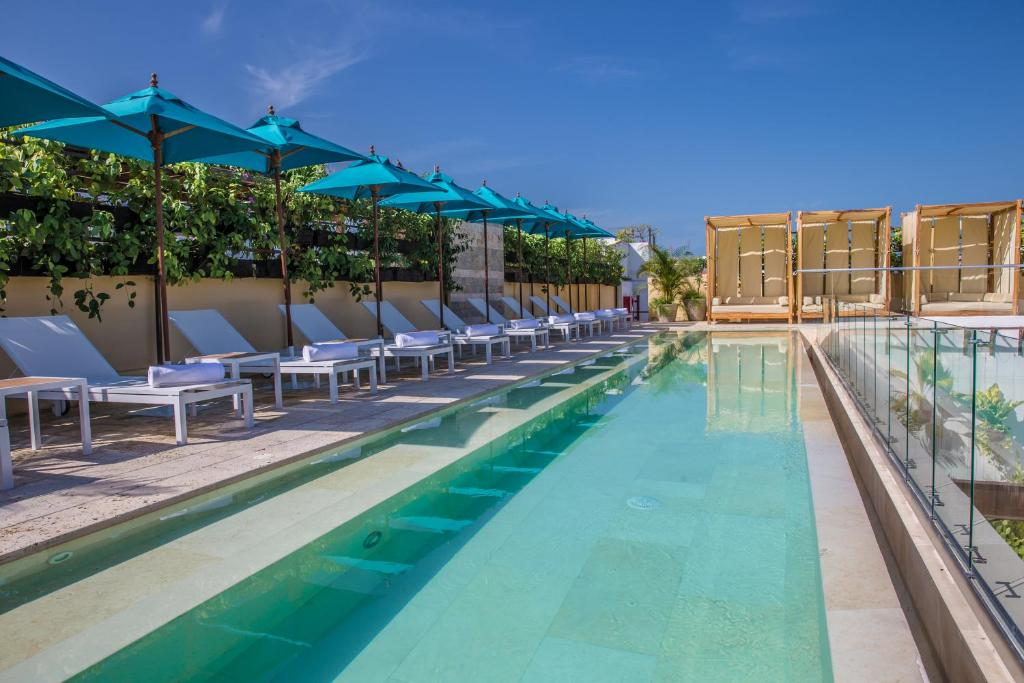 The swimming pool at or near Nacar Hotel Cartagena, Curio Collection by Hilton