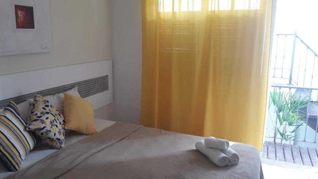 A bed or beds in a room at Porto Mar de Búzios