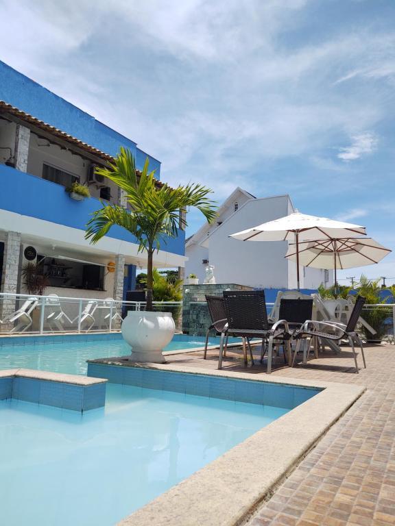 A piscina localizada em Pousada Maresia Costa Azul ou nos arredores