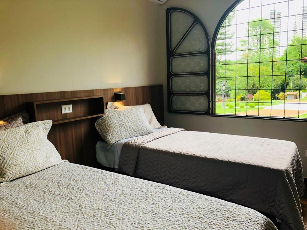 A bed or beds in a room at Hostel SLG