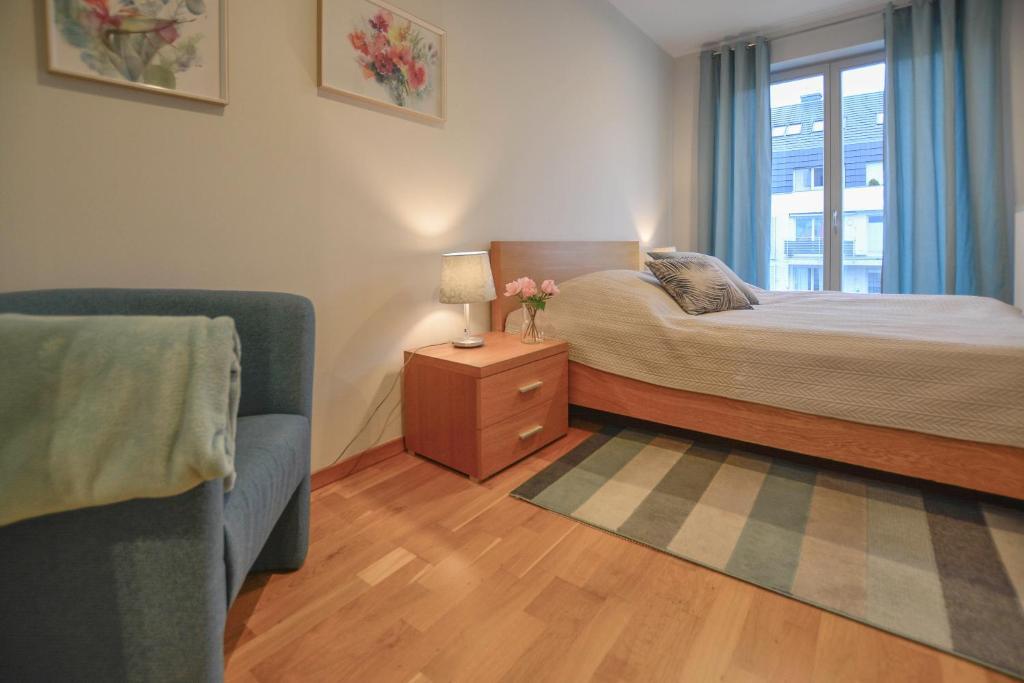 Łóżko lub łóżka w pokoju w obiekcie Apartamenty Na Wyspie - Casa Marina