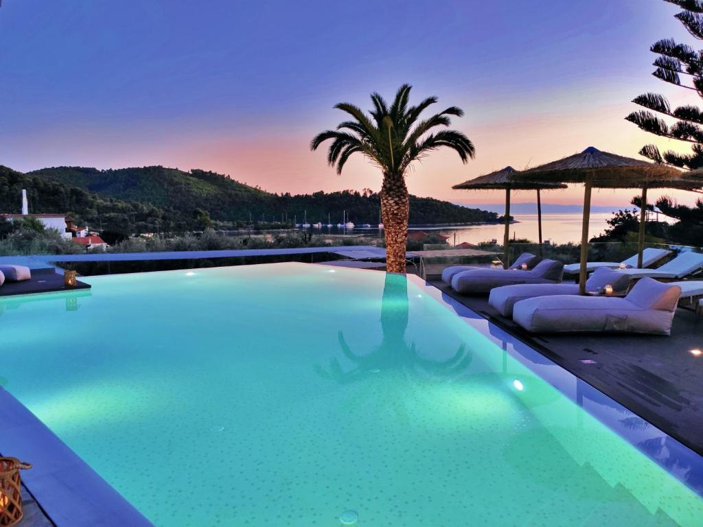 The swimming pool at or near Panormos Beach Hotel Skopelos