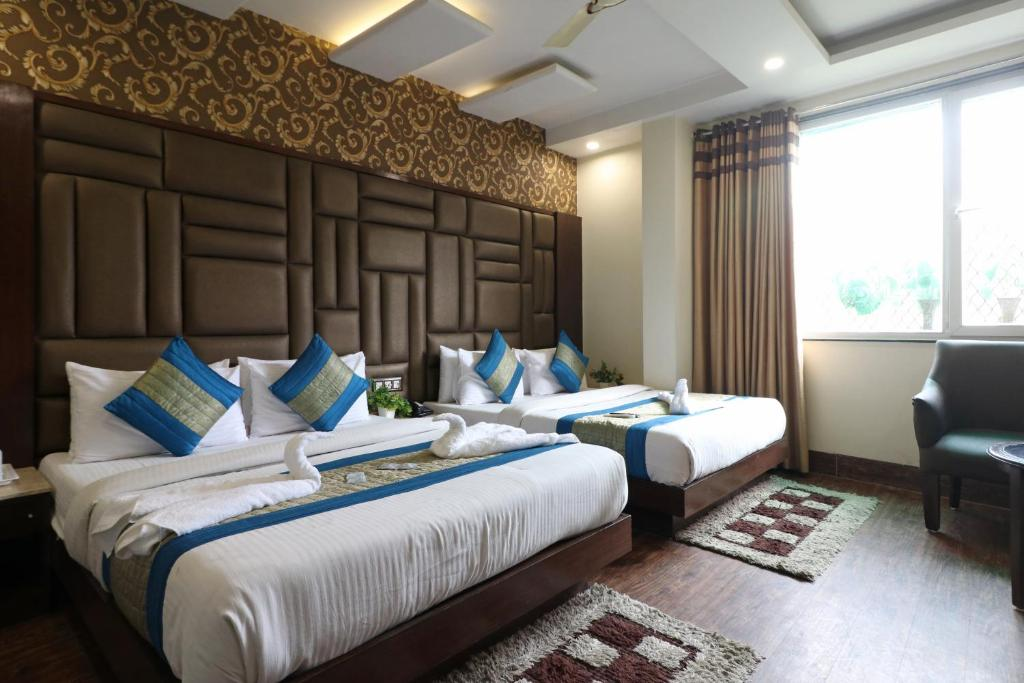A bed or beds in a room at Hotel Mannat international by Mannat