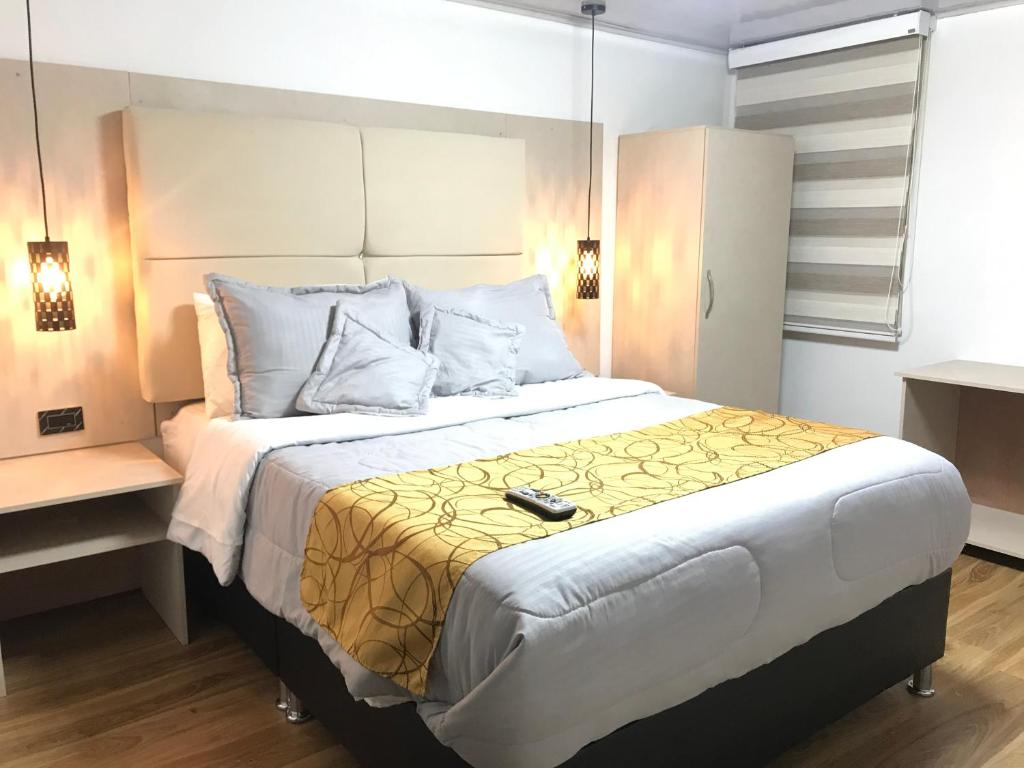 A bed or beds in a room at Hotel Casa Modelia